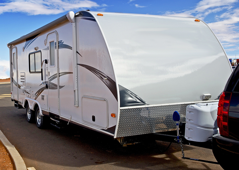 Towable camper vehicle seen while preforming rv inspection services alongside the road