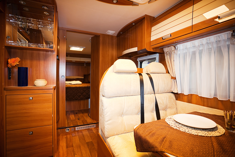 dining space and interior of a modern motorhome seen while preforming rv inspection services